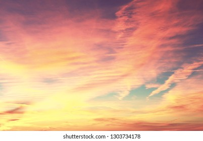 Unusual storm clouds at sunset. Bright living coral colors of the sky. Suitable for background.