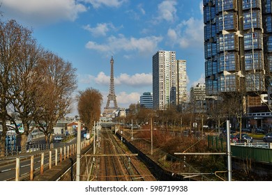 Unusual view to the Eiffel tower over the rails of Parisian subway line