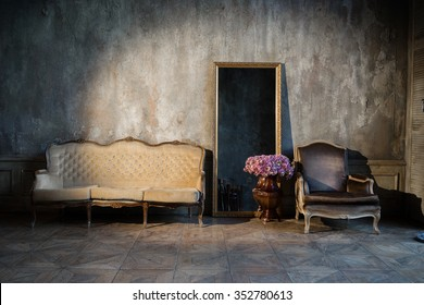 Unusual, vintage interior with a sofa and a mirror