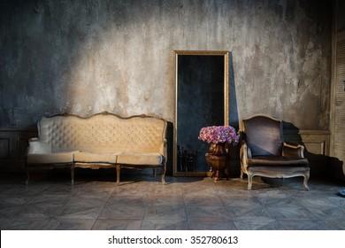 Unusual, vintage interior with a sofa and a mirror
