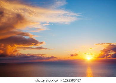 Unusual vivid clouds illuminated by the beams of the sun. Scenic image of textured sky. Ecology concept - climate change in the environment. Spectacular wallpaper. Discover the beauty of earth.