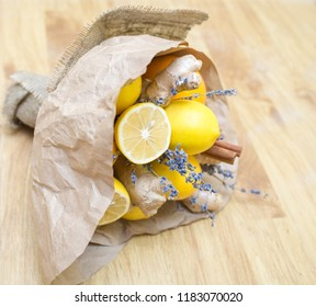 An unusual wedding bouquet of citrus, ginger, lavender and cinnamon is packed in kraft paper and rough fabric. Birthday gift hands made