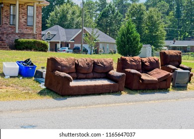 Unwanted and discarded furniture sitting on the side of road waiting on trash collectors to pick it up