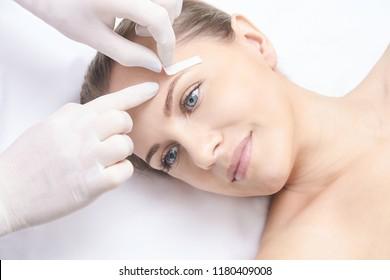 Unwanted hair wax epilation. Young Woman. cosmetology salon treatment procedure. Home waxing.