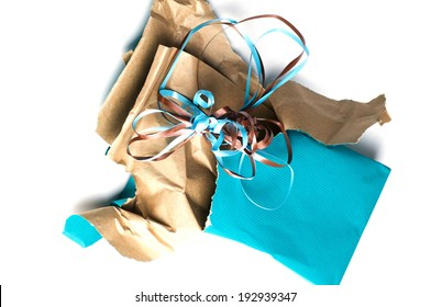 Unwrapped wrapping paper and ribbon at an angle