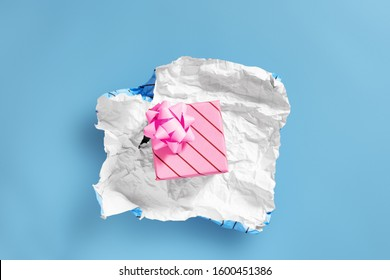 unwrapping present to find another layer of wrapping - Celebrations and events concept image with copy space for text.