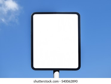 Unwritten sign in the sunny day on the blue sky
