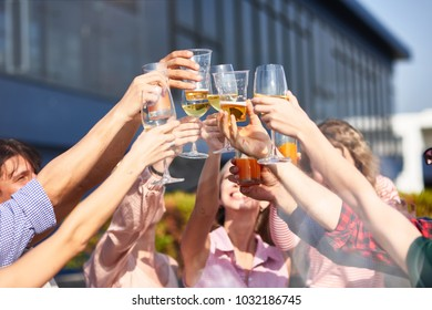 Upbeat mood. Close up cheerful young friends drinking beverages at the party