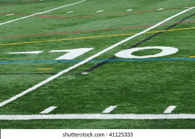 Upclose photo of the ten (10) yard line on the football field.  No other numbers or objects appear.