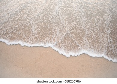 Up-close of the tide coming in at the beach.