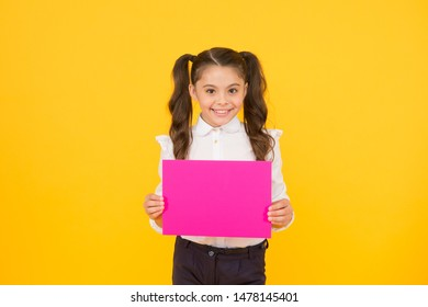 Upcoming event. Look here. Girl school uniform hold poster. Schoolgirl hold poster copy space. News information promotion. Changes coming. Back to school concept. Schoolgirl pupil show poster.