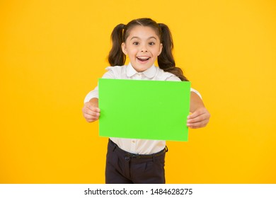 Upcoming event. Look here. Girl school uniform hold poster. Back to school concept. Schoolgirl pupil show poster. Schoolgirl hold poster copy space. News information promotion. Changes coming.