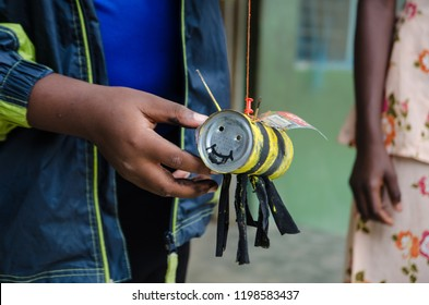 Upcycling in Ghana - toy bee made out of tin.