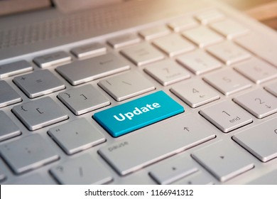 Update Button on Keyboard. Blue Color button on the gray silver keyboard of modern ultrabook. caption on the button