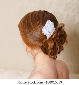 Updo with accessories bride photographed from the back closeup