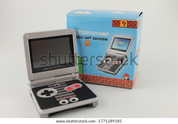 Upholland, Lancashire, Uk, 07/07/2020: Game boy advanced Sp, classic nes edition with box, isolated on a white background