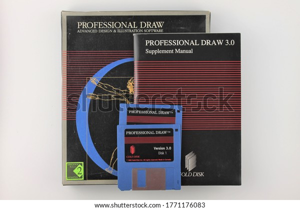 Upholland, Lancashire, UK, 07/07/2020: Professional draw, design and illustration software manual and floppy disks isolated on a white background