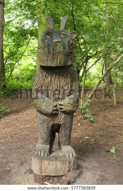 Upholland, Lancashire, UK, 16/07/2020: Wood carving of the Gruffalo in a woodland in Lancashire