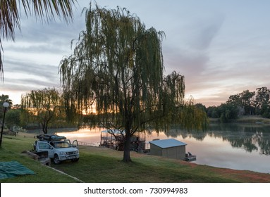 UPINGTON, SOUTH AFRICA - JUNE 12, 2017: Sunrise at Sakkie se Arkie, a holiday resort next to the Orange River at Upington, a town in the Northern Cape Province