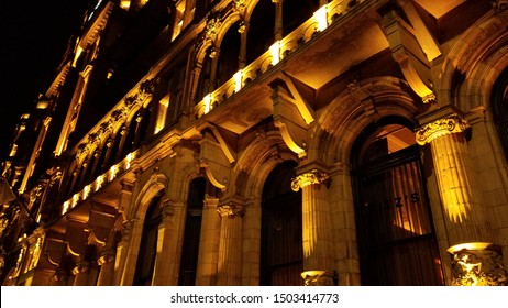 Up-Lit Greek style Building Facade at night with columns