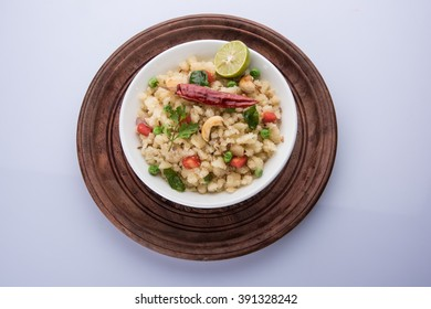 Upma or Uppittu is a popular breakfast dish in South India and Maharashtra. Semolina or Rava or coarse rice flour is main ingredients. Served in a bowl over colourful or wooden background