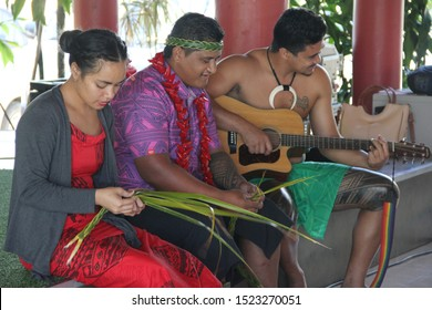 Upolu/Samoa_19 Sep 2019: Samoan villager singing their traditional song while weaving the headgear with palm leaves at Samoan cultural village.