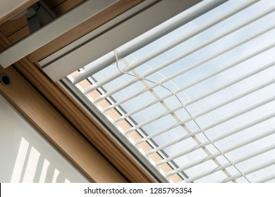Upper attic window with blinds