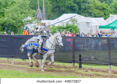 UPPER CANADA VILLAGE, MORRISBURG, ONTARIO, CANADA - JUNE 11, 2016: Jousting arena with knights on horseback at Medieval Festival.