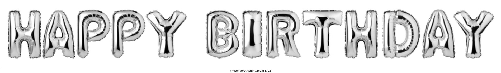 Upper case letters HAPPY BIRTHDAY from silver balloons