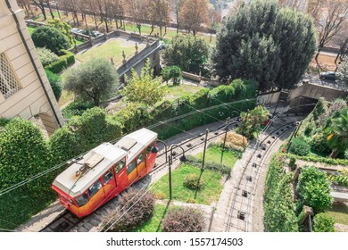 Upper city funicular line in Bergamo (Funicolare Citta Alta). Red funicular connects old Upper City and new. Scenic view of Bergamo historical center. Bergamo (upper town), ITALY - October 5, 2019