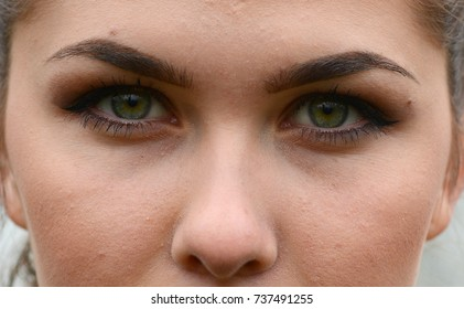Upper face of a girl with make up on looking at the camera, September 2017.
