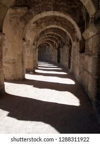 Upper gallery of the Aspendos Theater (Turkey). Beautiful stone arched gallery with play of light and shade. No people, interesting geometry.