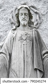 Upper half marble statue of Sacred Heart of Jesus. Jesus Christ stone sculpture with heart.