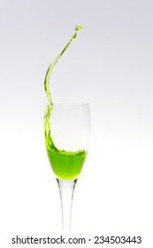Upper part of a champagne flute with splashing liquid