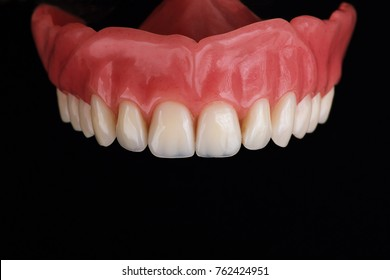 upper part of denture, removed on a black background