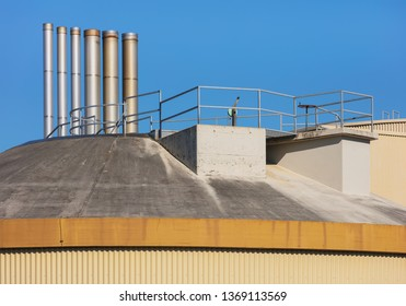 Upper part of an industrial facility against blue sky.