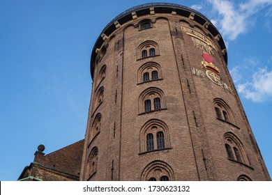 The upper part of the Round Tower  façade with a rebus inscription. Was built  as an astronomical observatory. Copenhagen, Denmark.