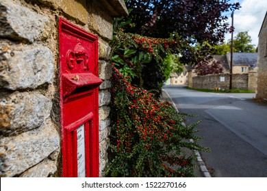 Upper Slaughter, Cheltenham / England - 09/12/2019: A Royal Mail post box in a Cotswold village.