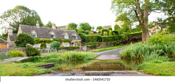 UPPER SLAUGHTER UK - JULY 21, 2019: Aerial view of the Ford at the Village of Upper Slaughter in the Cotswolds, Upper Slaughter, Glocestershire, England