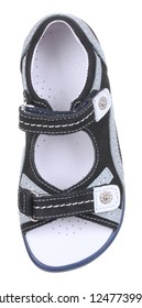 Upper view of black, gray, blue and white suede boy sandal with slits and slots, perforated insole and two velcros, isolated on white (FOCUS ON INSOLE)