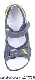 Upper view of blue and yellow leather and suede boy sandal with slits and slots, perforated insole and two velcros, isolated on white (FOCUS ON INSOLE)