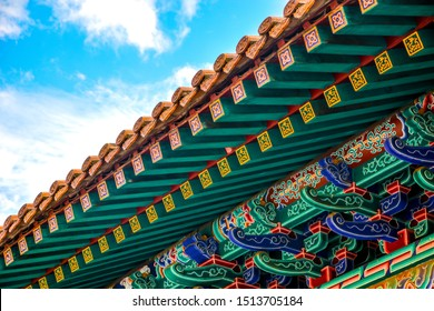 Upper view of Chinese Traditional colorful Pavilion roof under bright blue sky background