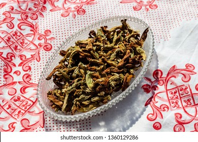 a upper view closeup food shoot to dried peppers in ellipsis plate. photo has taken at a village at turkey.