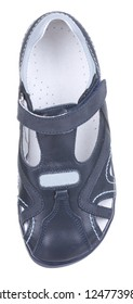 Upper view of dark blue and gray leather and suede boy sandal with slits and slots, perforated insole and velcro, isolated on white (FOCUS ON INSOLE)