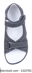 Upper view of dark blue and white suede boy sandal with perforation, slits and slots, and two velcros, isolated on white