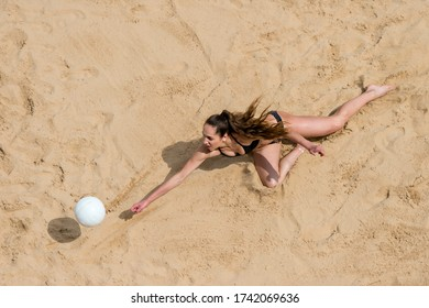Upper View of Female  Beach Volleyball Player at Service