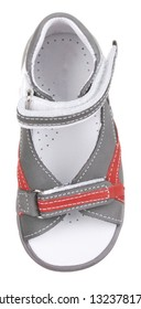 Upper view of gray, red and white suede boy sandal with two velcros and slits and slots, isolated on white