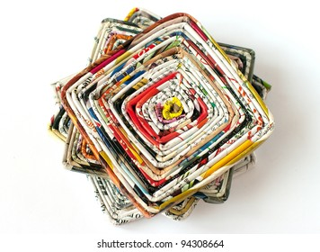 Upper view to pile of coasters made of old magazines