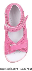 Upper view of pink and white suede girl sandal with perforation, slits and slots, and two velcros, isolated on white