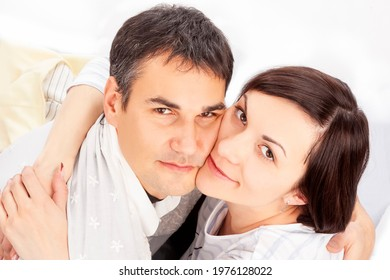 Upper View of Portrait of Caucasian Family Couple Sitting Embraced Against White Background. Horizontal Image - Shutterstock ID 1976128022